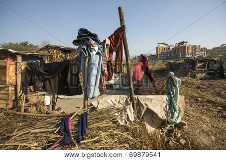 KATHMANDU, NEPAL - DEC 16, 2013: Illegal houses at slums in Tripureshwor district. Caste of untouchables in Nepal, is about 7 % of population.