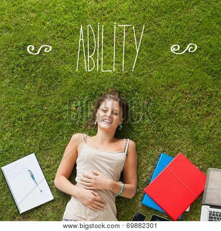 The word ability against pretty student lying on grass