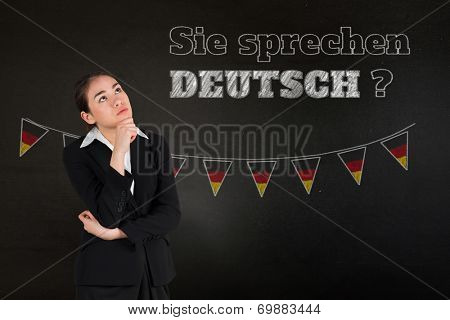 Businesswoman thinking against black, Do you speak German?