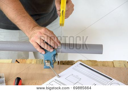 A Plumber Cut Pvc Pipe