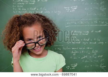 Cute pupil tilting glasses against rocket science theory