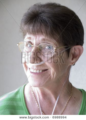 Femaile Senior Citizen With A Breathing Mask