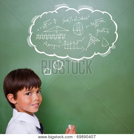 Math in thought bubble against cute pupil holding chalk
