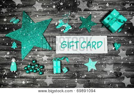 Christmas Gift Card For A Xmas Coupon Decorated In Mint Green, Wood And White.