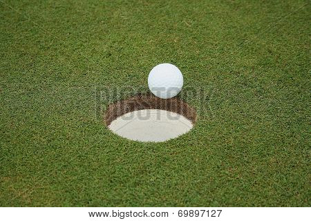 Golf ball enters hole