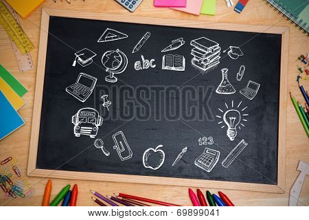 Composite image of education doodles against chalkboard