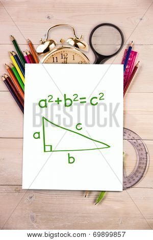 Trigonometry against students desk with white page