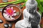 image of buddha  - Spa and wellness setting with buddha and flowers - JPG