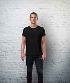 stock photo of casual wear  - Man wearing black t - JPG