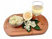 foto of elderberry  - Health drink made from elderberry flowers on a white background - JPG