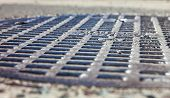 picture of manhole  - Close up of the metal manhole cover. ** Note: Shallow depth of field - JPG