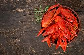 foto of crawfish  - Bowl of fresh boiled crawfish on the old wooden background