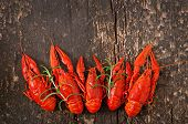 picture of crawfish  - Fresh boiled crawfish on the old wooden background - JPG