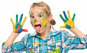 foto of sticking out tongue  - Portrait of a cute girl showing her hands painted in bright colors and sticking tongue out - JPG