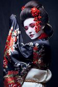 picture of geisha  - young pretty geisha in kimono with sakura and decoration - JPG