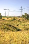 foto of ravines  - Line of electricity transmissions on verge of ravine - JPG