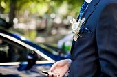 stock photo of boutonniere  - Close Up of White Flower Boutonniere on Formal Black Tuxedo - JPG