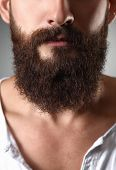 foto of hooligans  - Part of a mans face with  beard - JPG
