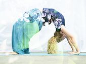 picture of dhanurasana  - Double exposure portrait of young woman performing back bend combined with photograph of nature - JPG