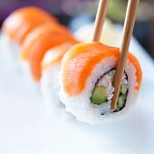 foto of picking tray  - picking up a piece of sushi with chopsticks - JPG