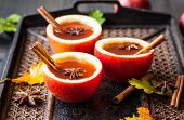 picture of cider apples  - Apple cider with cinnamon sticks and anise star in apple cups - JPG