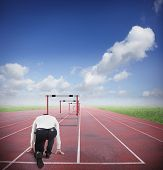 pic of overcoming obstacles  - Businessman run to jumping business obstacles in a track - JPG