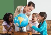 picture of pupils  - Cute pupils and teacher in classroom with globe at the elementary school - JPG