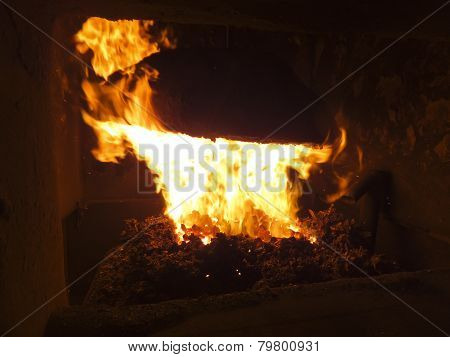 flame in a small coal boiler