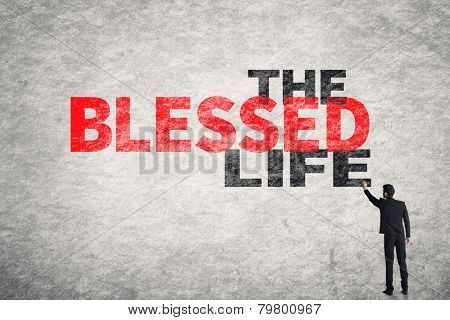 Asian businessman write text on wall, The Blessed Life