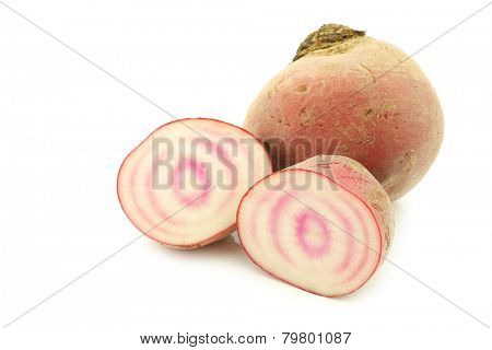 freshly harvested red beet root and two halves on a white background