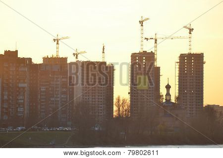 Houses Under Construction At Sunset