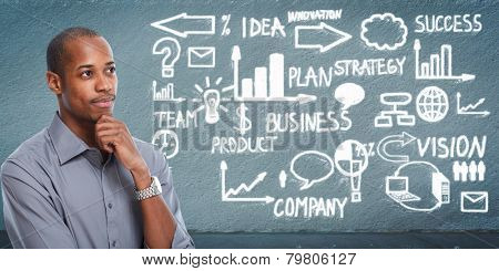 Black businessman looking business scheme. Creative background
