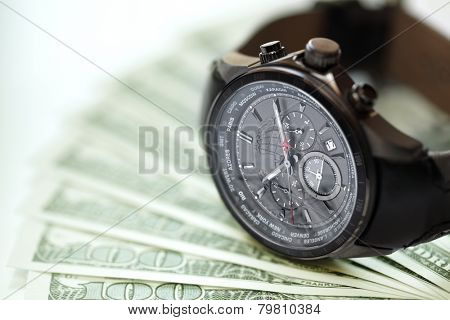 Watch and money concept for business investment or time is money