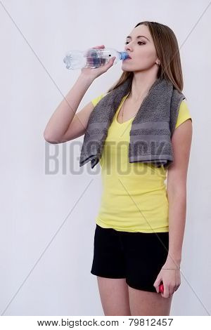 Girl drinks water after training