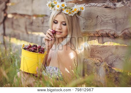Rural woman with a bucket of ripe berries.