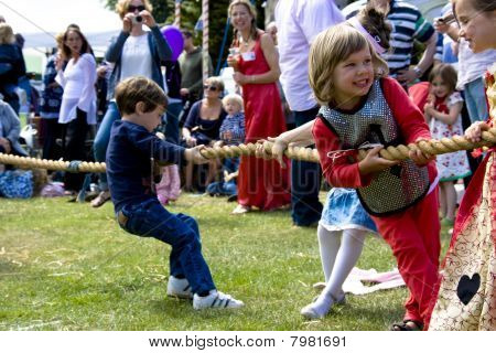 Children play tug-of-war