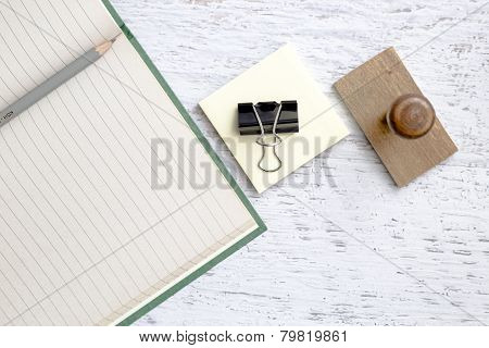 Closeup Of Notebook, Pencil And Paper