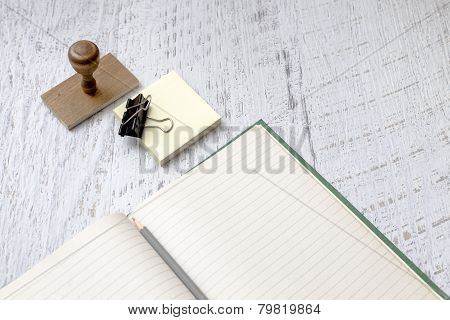 Blank Notebook And Stamp On textured Background