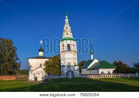 Leaning Bell Tower And Two Churches In The Village Of Kideksha. Russia