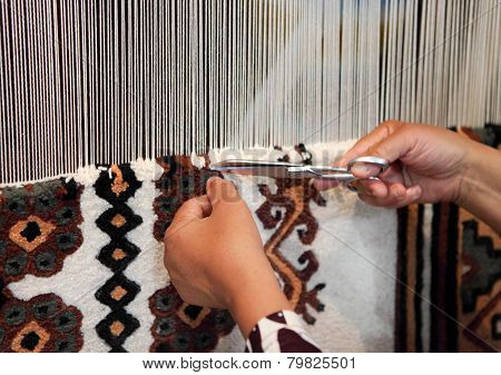 Woman Working At The Loom. Close Up