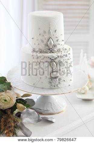 White Wedding Cake With Silver Decoration
