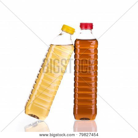 Bottles full of vinegar.