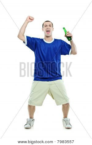 Excited football fan with a beer in his hand watching sport