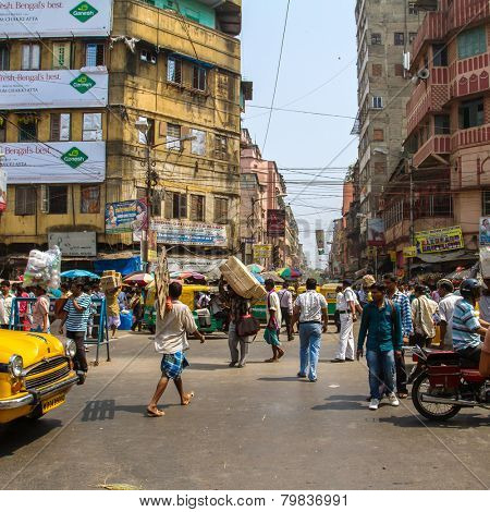 KOLKATA, INDIA - MARCH 13: Big city street with thousands of people, bikes and the buses on March 13, 2013 in Kolkata, India. Kolkata has a density of 814.80 vehicles per km road length.