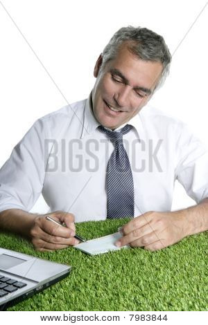 Senior Businessman Sign Check Green Grass