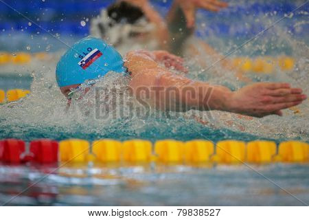 GRAZ, AUSTRIA - APRIL 04, 2014: Robert Zbogar (Slovenia) places 2nd in the men's 100m butterfly event in an indoor swimming meeting.
