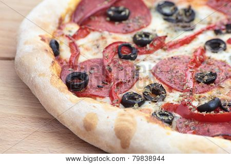 Pizza with pepperoni.