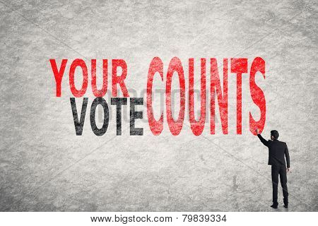 Asian businessman write text on wall, Your Vote Counts