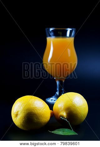 Lemons And Juice Glass On A Black Background