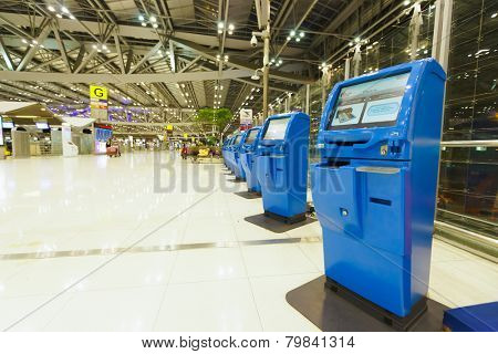 BANGKOK, THAILAND - NOV 07: check-in self service terminals on November 07, 2014. Suvarnabhumi Airport is one of two international airports serving Bangkok.